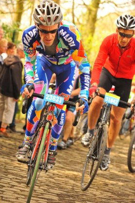 DKHQ Partner Tim Dalton attacking the cobbles in full Mapei on a Colnago.