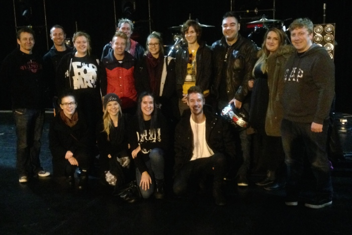 Tim Dalton backstage and on stage with students at 5 Seconds of Summer.